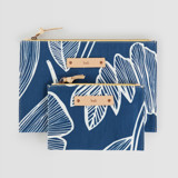 This is a blue zipper pouch by Beth Schneider called Lined Florals.