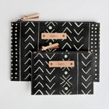This is a black zipper pouch by Erin Deegan called mud cloth organic.
