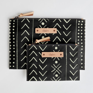 This is a black zipper pouch by Erin Deegan called mud cloth organic.