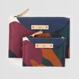 This is a purple zipper pouch by Amina Taylor called When Frankie Met Flora.