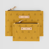 This is a yellow zipper pouch by Erika Firm called Espace Triangle.