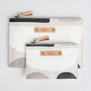 This is a grey zipper pouch by Iveta Angelova called Dreamland.