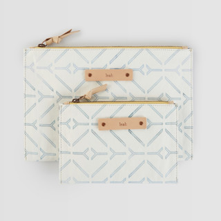 This is a white zipper pouch by Carolyn Nicks called Coastal in standard.