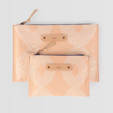 This is a pink zipper pouch by Tanya Lee Design called Eyelet Blush.