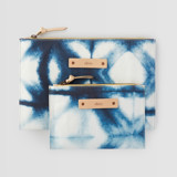 This is a blue zipper pouch by Agnes Pierscieniak called Indigo Diamond.