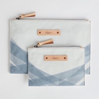 This is a blue zipper pouch by Roopali called Crisscross in standard.