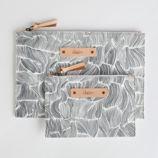 This is a black and white zipper pouch by Vivian Yiwing called Breeze.