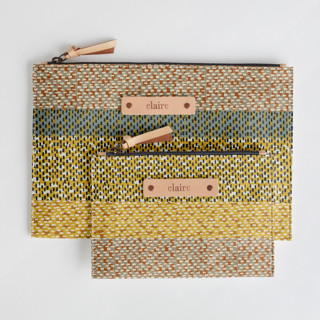 This is a yellow zipper pouch by Bethania Lima called Basic.
