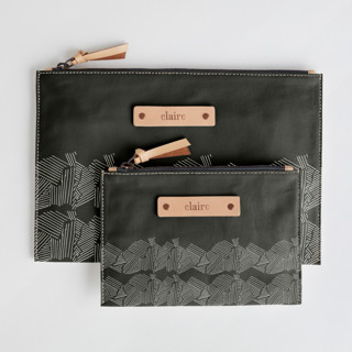 This is a black zipper pouch by Deborah Velasquez called Savanna Grassland.