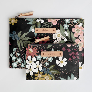 This is a black zipper pouch by Alethea and Ruth called Wildflower Scatter.