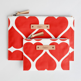 This is a red zipper pouch by kelli hall called Big Heart in standard.
