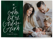 This is a green photo christmas card by Jackie Crawford called Hand Letter Adore Him Script with standard printing on smooth signature in standard.