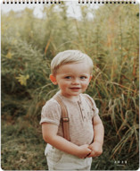 This is a white photo calendar by Sara Hicks Malone called Wonder printing on premium calendar paper in standard.