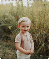 This is a white photo calendar by Sara Hicks Malone called Wonder printing on premium calendar paper in grand.