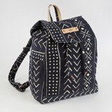This is a black canvas backpack by Erin Deegan called mud cloth organic.