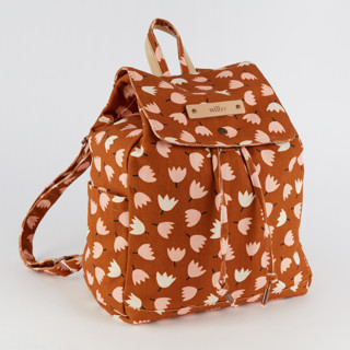 This is a orange canvas backpack by Iveta Angelova called Tulip Fields.