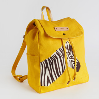 This is a yellow canvas backpack by Cass Loh called vibrant zebra in standard.