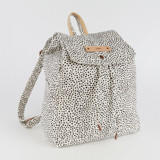 This is a black and white canvas backpack by Up Up Creative called Effervesce.