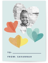 This is a green kids valentines day card by Carrie Moradi called flittering hearts with standard printing on signature in standard.