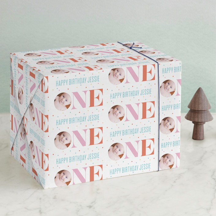 """One"" - Bold typographic Wrapping Paper in Carnation by Carrie ONeal."