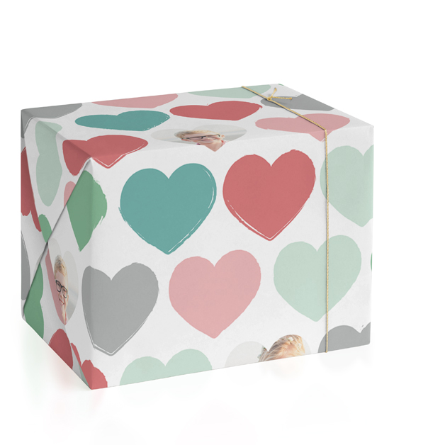 This is a colorful wrapping paper by Jessie Steury called Painted Hearts with standard printing on wrapping paper.
