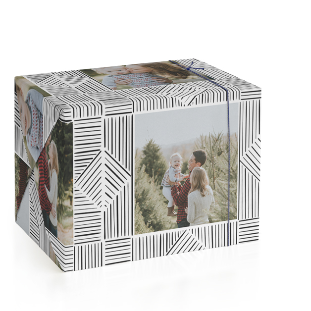This is a black and white wrapping paper by Leanne Friedberg called line doodle photo frames with standard printing on wrapping paper.