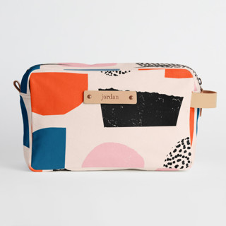 This is a pink dopp kit by Iveta Angelova called Playground in standard.