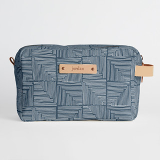 This is a blue dopp kit by Creo Study called Steps in standard.