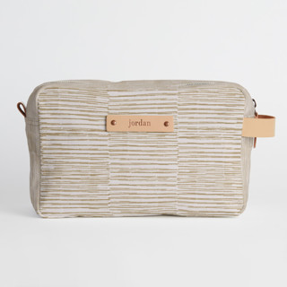 This is a brown dopp kit by Alethea and Ruth called Dashed Stripes in standard.