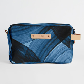 This is a blue dopp kit by Iveta Angelova called tides in standard.