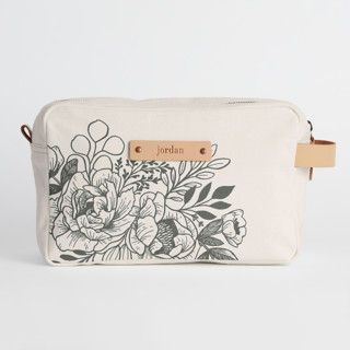 This is a black dopp kit by Genna Blackburn called Etched Flowers in standard.