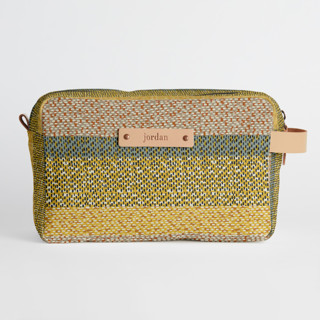 This is a yellow dopp kit by Bethania Lima called Basic in standard.