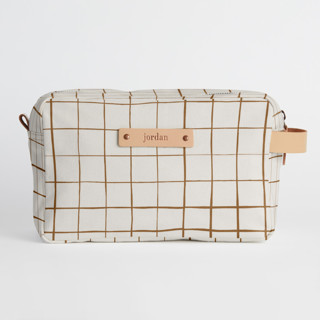 This is a brown dopp kit by Carolyn Nicks called Montauk in standard.