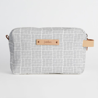 This is a grey dopp kit by Oma N. Ramkhelawan called Woven in standard.