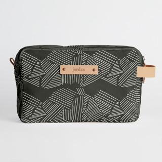 This is a black dopp kit by Deborah Velasquez called Savanna Grassland in standard.