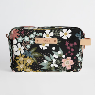 This is a black dopp kit by Alethea and Ruth called Wildflower Scatter.