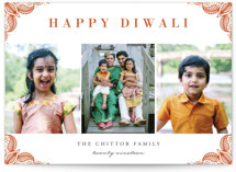 This is a orange diwali card by Oma N. Ramkhelawan called Rangoli Corners printing on smooth signature in standard.