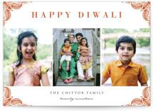 This is a orange diwali card by Oma N. Ramkhelawan called Rangoli Corners printing on smooth signature in standard.