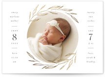 This is a white birth announcement postcard by Kelly Schmidt called Golden Wreath with foil-pressed printing on signature in postcard.
