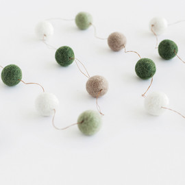 This is a white holiday garland by Minted called Snow Covered Woods Large.