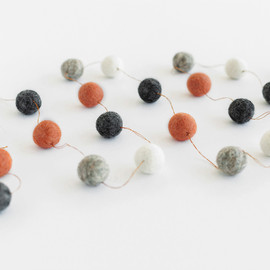 This is a grey holiday garland by Minted called Rosy Glow Large.