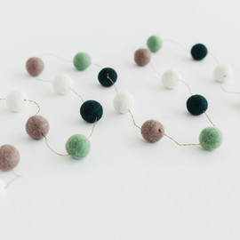 This is a blue holiday garland by Minted called Frozen Pond Large.