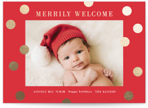 This is a red babys first christma by Angela Garrick called a merry welcome with foil-pressed printing on smooth signature in standard.