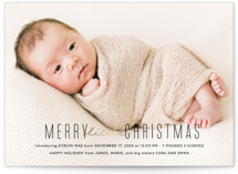 This is a black babys first christma by Ink and Letter called Merry Little Christmas with foil-pressed printing on smooth signature in standard.