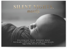 This is a white babys first christma by Lori Wemple called Mostly Silent Nights with foil-pressed printing on smooth signature in standard.