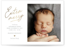 This is a white babys first christma by Shari Margolin called Extra Merry with foil-pressed printing on smooth signature in standard.