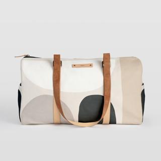 This is a grey duffle bag by Iveta Angelova called Dreamland.