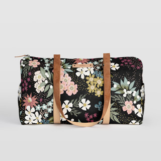 This is a black duffle bag by Alethea and Ruth called Wildflower Scatter.