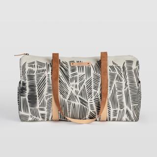 This is a black duffle bag by Oma N. Ramkhelawan called Streetwise.