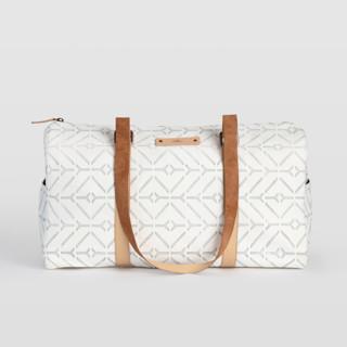 This is a white duffle bag by Carolyn Nicks called Coastal.